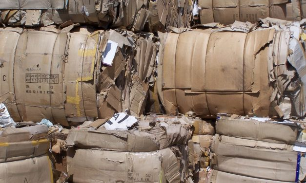 How can a cardboard baler help with business waste?